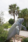 A statue of the West Indian Manatee, which is sometimes sighted here in the Caloosahatchee River, greets the visitor.