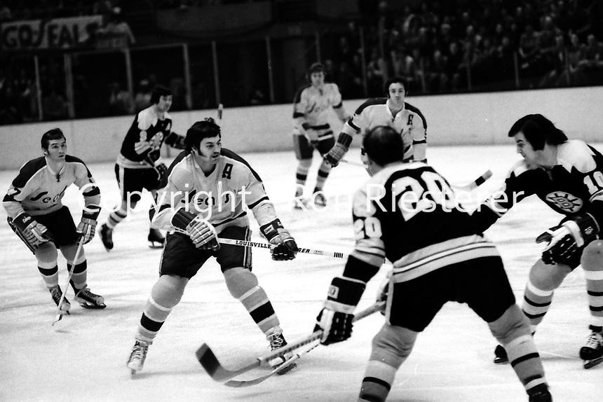 California Golden Seals vs Boston Bruins, 1973 action:<br />Seals Hilliard Graves, Ivan Boldirev, Bruins Dallas Smith, and Carol Vadnais. (photo/Ron Riesterer)