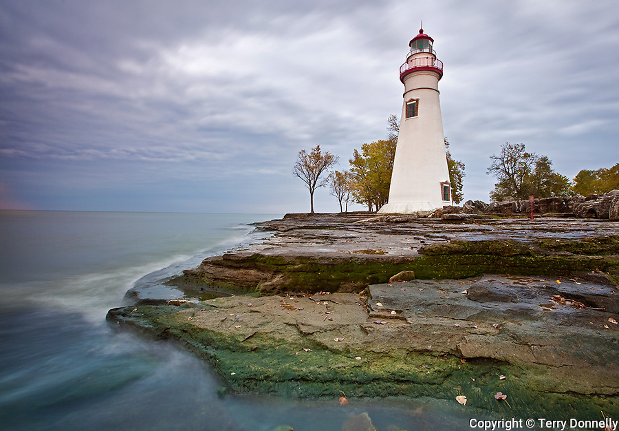 Marblehead Lighthouse State Park, OH<br /> Gathering clouds above Marblehead Lighthouse (1819) standing on the rocky shoreline of Lake Erie, oldest lighthouse in continuous operatoin on the great lakes