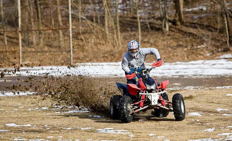 WATERBURY, CT - 09 FEBRUARY 2010 -020910JT02--<br /> Adam Cross, a Supercross racer from Waterbury, rides an all terrain vehicle through mud and snow in a Waterbury park on Tuesday.<br /> Josalee Thrift Republican-American