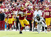 Washington Redskins outside linebacker Ryan Kerrigan (91) intercepts a pass he returned for a touchdown in the second quarter against the Philadelphia Eagles at FedEx Field in Landover, Maryland on Sunday, September 10, 2017.  Philadelphia Eagles running back Darren Sproles (43) looks on from the right.<br /> Credit: Ron Sachs / CNP