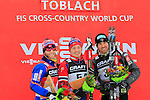 Martin Johnsrud Sundby , Finn Haagen Krogh, Maurice Manificat at the podium of Tour de ski as part of the FIS Cross Country Ski World Cup  in Dobbiaco, Toblach, on January 8, 2016. Finn Haagen Krogh wins the stage. Martin Johnsrud Sundby (2nd) remains leader. French Maurice Manificat is third. Credit: Pierre Teyssot