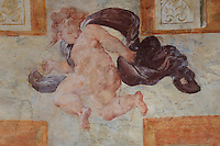 Fresco of Cupid, painted c. 1552 by Niccolo dell'Abatte after drawings by Primaticcio, in the window recesses of the Ballroom or Galerie Henri II, Chateau de Fontainebleau, France. The Palace of Fontainebleau is one of the largest French royal palaces and was begun in the early 16th century for Francois I. It was listed as a UNESCO World Heritage Site in 1981. Picture by Manuel Cohen