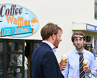 Racegoers keep cool with ice cream during Afternoon Racing at Salisbury Racecourse on 16th May 2019
