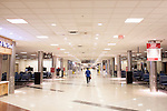 A man walks through a nearly empty A Terminal at Hartsfield–Jackson Atlanta International Airport, in Atlanta, Georgia on August 28, 2013.