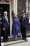 Mrs Margaret Thatcher 1983 election outside 10 Downing Street waving to crowd with her husband Denis Thatcher and duty policeman. London UK