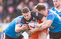 Picture by Allan McKenzie/SWpix.com - 11/03/2018 - Rugby League - Betfred Super League - Castleford Tigers v Salford Red Devils - the Mend A Hose Jungle, Castleford, England - Castleford's Jamie Ellis is tackled by Salford's Tyrone McCarthy.