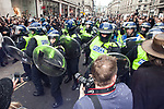 """© Joel Goodman - 07973 332324 . 26/03/2011 . London , UK . Police with riot shields intervene after protesters build a fire in a road junction at Oxford Circus . Hundreds of thousands of people attend an anti cuts demonstration under the banner """" March for the Alternative """" in central London , in protest at the coalition government's austerity measures . Photo credit : Joel Goodman"""