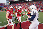 Wisconsin Badgers  captains Patrick Butrym (95), Aaron Henry (7), Nick Toon (87), and Bradie Ewing (34) shake hands after the coin toss prior to an NCAA Big Ten Conference college football game against the Penn State Nittany Lions on November 26, 2011 in Madison, Wisconsin. The Badgers won 45-7. (Photo by David Stluka)