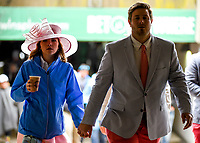 LOUISVILLE, KY - MAY 06: A man and women hold hands as they walk on Kentucky Derby Day at Churchill Downs on May 6, 2017 in Louisville, Kentucky. (Photo by Scott Serio/Eclipse Sportswire/Getty Images)