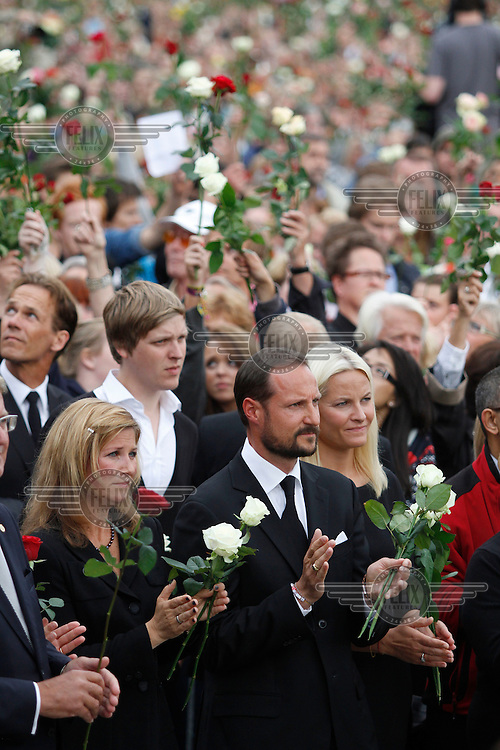 (Oslo July 25, 2011) Princess Märtha Louise, Crown Prince Haakon , and HRH Mette-Marit listen to a speach. An estimated 150,000 people gathered in Oslo town centre for a vigil following Friday's twin extremist attacks ...A large vehicle bomb was detonated near the offices of Norwegian Prime Minister Jens Stoltenberg on 22 July 2011. .Another terrorist attack took place shortly afterwards, where a man killed 68 people, mainly children and youths attending a political camp at Utøya island. ..Anders Behring Breivik was arrested on the island and has admitted to carrying out both attacks..(photo:Fredrik Naumann/Felix Features)