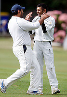 B Thakker (R) of Harrow celebrates dismissing G Arnold during the Middlesex County Cricket League Division Three game between North Middlesex and Harrow at Park Road, Crouch End on Sat Aug 7, 2010.