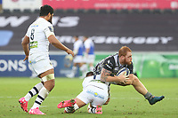 Dan Baker of Ospreys is tackled by Alexandre Lapandry of Clermont during the Champions Cup Round 1 match between Ospreys and Clermont at The Liberty Stadium, Swansea, Wales, UK. Sunday 15 October 2017
