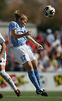 OCT 2, 2005: College Park, MD, USA:  UNC Tarheel midfielder #17 Lori Chalupny heads a ball while playing the Maryland Terrapins at Ludwig Field.  UNC won, 4-0. Mandatory Credit: Photo By Brad Smith (c) Copyright 2005 Brad Smith