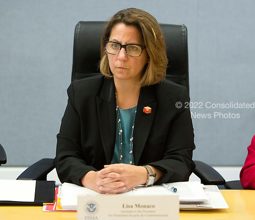 Lisa Monaco, United States Homeland Security Advisor to US President Barack Obama listens after receiving a briefing on Hurricane Matthew at the Federal Emergency Management Agency (FEMA) in Washington DC, October 5, 2016.<br /> Credit: Chris Kleponis / Pool via CNP
