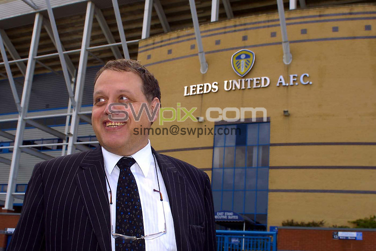 Pix: Simon Wilkinson/SWpix.com Football. Leeds United relegation story. 04/05/2004..COPYRIGHT PICTURE>>SIMON WILKINSON>>01943 608782>>..A beaming Gerald Krasner emerges from a board meeting at Elland Road today.