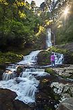 NEW ZEALAND, The Catlins, Woman admiring McLean Falls,  Ben M Thomas