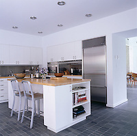 The kitchen has bespoke units, island and worktops which were all designed by Deborah Berke
