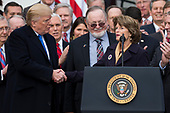 United States President Donald J. Trump shakes hands with United States Senator Lisa Murkowski, Republican of Alaska, during an event on the South Lawn of the White House after the United States Congress passed the Republican sponsored tax reform bill, the 'Tax Cuts and Jobs Act' in Washington, D.C. on December 20th, 2017. Credit: Alex Edelman / CNP