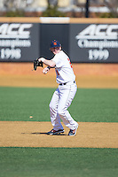 Bucknell Bison third baseman Sam Clark (26) makes a throw to first base against the Georgetown Hoyas at Wake Forest Baseball Park on February 14, 2015 in Winston-Salem, North Carolina.  The Hoyas defeated the Bison 8-5.  (Brian Westerholt/Four Seam Images)
