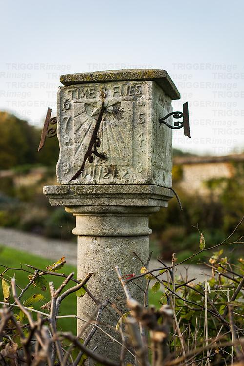 Old stone sundial in a garden in England