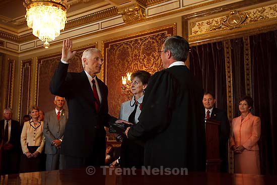Salt Lake City - Greg Bell is sworn in as the state's Lieutenant Governor Tuesday, September 1 2009 at the State Capitol. With him is his wife, JoLynn Bell and Judge David Connors.