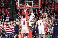 RALEIGH, NC - JANUARY 9: Manny Bates #15 of North Carolina State University dunks the ball during a game between Notre Dame and NC State at PNC Arena on January 9, 2020 in Raleigh, North Carolina.
