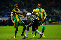 Bolton Wanderers' Clayton Donaldson holds off the challenge from West Bromwich Albion's Craig Dawson and Mason Holgate <br /> <br /> Photographer Alex Dodd/CameraSport<br /> <br /> The EFL Sky Bet Championship - Bolton Wanderers v West Bromwich Albion - Monday 21st January 2019 - University of Bolton Stadium - Bolton<br /> <br /> World Copyright © 2019 CameraSport. All rights reserved. 43 Linden Ave. Countesthorpe. Leicester. England. LE8 5PG - Tel: +44 (0) 116 277 4147 - admin@camerasport.com - www.camerasport.com