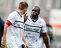 A not so friendly end to the friendly as Raith Rovers' Christian Nade has a heated conversation with captain Jason Thomson as they head towards the tunnel.