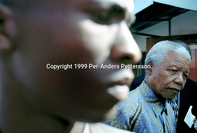 EASTCOURT, SOUTH AFRICA - MAY 1: Former President Nelson Mandela of South Africa greets school children during a election stop on May 1, 1999 in Eastcourt, South Africa. The ANC freedom fighter was in prison for 27 years and released in 1990. He became President of South Africa after the first multiracial democratic elections in April 1994. Mr. Mandela retired after one term in 1999 and gave leadership to the current president Mr. Thabo Mbeki. (Photo by Per-Anders Pettersson)
