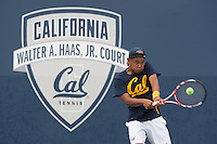 J.T. Nishimura hits the ball. Cal played Washington at the Hellman Tennis Complex in Berkeley, California on April 8, 2016.