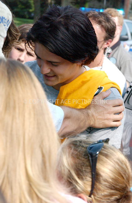** FEE MUST BE AGREED BEFORE USE **..Orlando Bloom, who is in Kentucky, filming his next movie, 'Elizabethtown' spotted departing from film set in Versailles. Despite presence of heavy police force consisting of local policemen and state troopers, Bloom got mobbed by a crowd of teenage female admirers. At some point, Bloom was even forced by fans to accept a yellow t-shirt from one of the girls. Versailles, Kentucky, July 19, 2004. Please byline: ACEPIXS.COM.   .. *** ***  ..Ace Pictures, Inc  **  ..contact: Alecsey Boldeskul (646) 267-6913 **..Philip Vaughan (646) 769-0430 **..e-mail: info@acepixs.com
