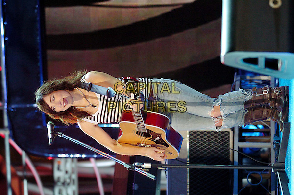 KT TUNSTALL.Festivalbar Music Festival at Piazza Castello, Turin, Italy..June 4th, 2005.Foto Omega/Garofalo.full length stage concert live performance gig music guitar ripped torm jeans denim tucked into boots.www.capitalpictures.com.sales@capitalpictures.com.© Capital Pictures.