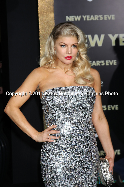 """LOS ANGELES - DEC 5:  Fergie aka Stacy Ferguson arrives at the """"New Year's Eve"""" World Premiere at Graumans Chinese Theater on December 5, 2011 in Los Angeles, CA"""