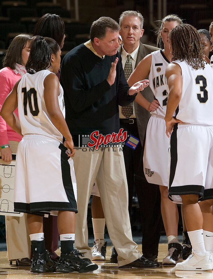 Wake Forest Demon Deacons head coach Mike Petersen talks to his team during a time out versus the Wright State Raiders at the LJVM Coliseum on December 5, 2007 in Winston-Salem, NC.
