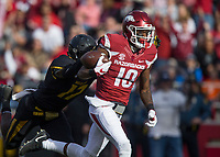 Hawgs Illustrated/BEN GOFF <br /> Jordan Jones (10), Arkansas wide receiver, evades DeMarkus Acy, Missoui cornerback, after catching a pass for a 57 yard touchdown in the first quarter Friday, Nov. 24, 2017, at Reynolds Razorback Stadium in Fayetteville.