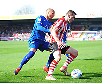 Lincoln City's Harry Toffolo shields the ball from Tranmere Rovers' Jake Caprice<br /> <br /> Photographer Andrew Vaughan/CameraSport<br /> <br /> The EFL Sky Bet League Two - Lincoln City v Tranmere Rovers - Monday 22nd April 2019 - Sincil Bank - Lincoln<br /> <br /> World Copyright © 2019 CameraSport. All rights reserved. 43 Linden Ave. Countesthorpe. Leicester. England. LE8 5PG - Tel: +44 (0) 116 277 4147 - admin@camerasport.com - www.camerasport.com
