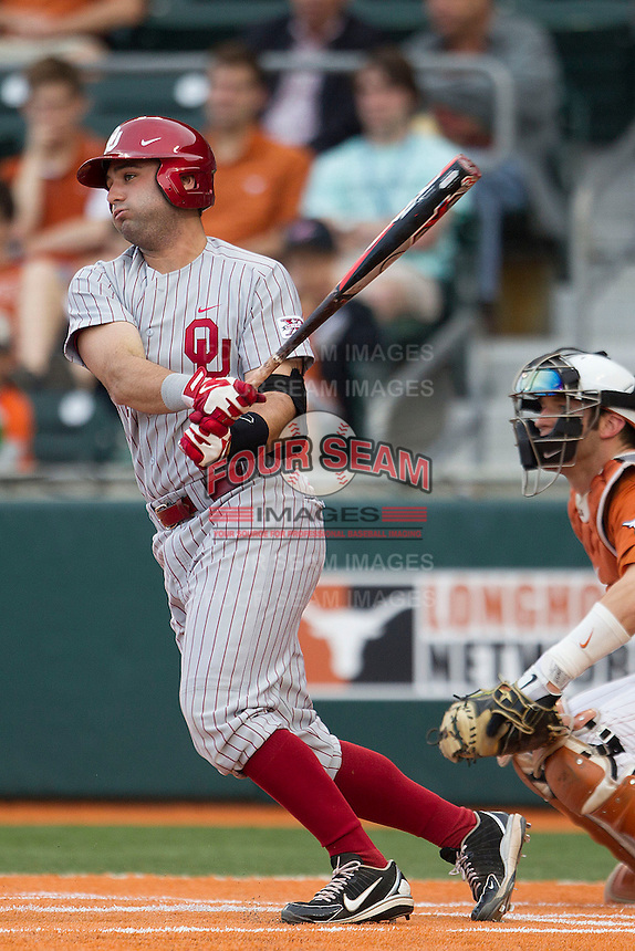 Oklahoma Sooners catcher Anthony Hermelyn #9 follows through on his swing against the Texas Longhorns in the NCAA baseball game on April 5, 2013 at UFCU DischFalk Field in Austin Texas. Oklahoma defeated Texas 2-1. (Andrew Woolley/Four Seam Images).