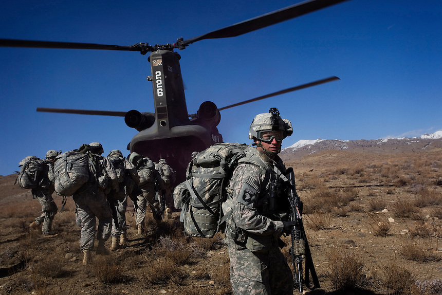 Staff Sgt. Grant Goepp pulls security while members of Baker Company, 1/506th Infantry,  prepare for extraction after a search operation in the village of Marzak, Paktika Province, Afghanistan, Friday, Feb. 27, 2009.