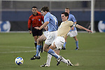 12 December 2008: Billy Schuler (left) of North Carolina avoids a tackle by Sam Cronin (2) of Wake Forest.  The Wake Forest University Demon Deacons were defeated by the University of North Carolina Tar Heels 0-1 at Pizza Hut Park in Frisco, TX in an NCAA Division I Men's College Cup semifinal game.