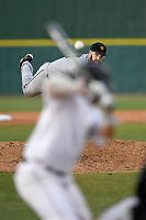 Starting pitcher AJ Moore (23) of the Kennesaw State Owls delivers a pitch in a game against the University of South Carolina Upstate Spartans on Thursday, March 29, 2018, at Cleveland S. Harley Park in Spartanburg, South Carolina. (Tom Priddy/Four Seam Images)