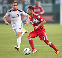 CARSON, CA – July 9, 2011: LA Galaxy midfielder Chris Birchall (8) and Chicago Fire midfielder Daniel Paladini (11) during the match between LA Galaxy and Chicago Fire at the Home Depot Center in Carson, California. Final score LA Galaxy 2, Chicago Fire FC 1.