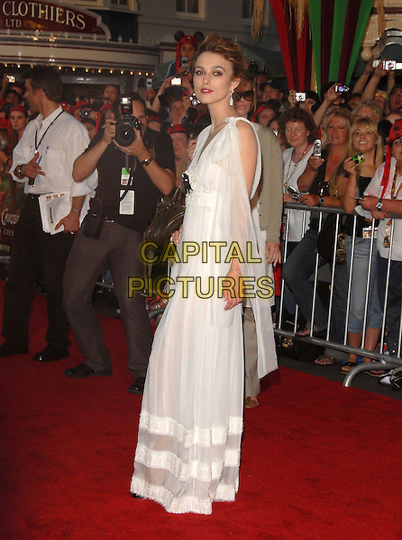"KEIRA KNIGHTLEY.at Disney's ""Pirates of the Caribbean 2: Dead Man's Chest"" World Premiere held at Disneyland in Anaheim, Los Angeles, California, USA, June 24th 2006. .full length kiera knightly long sheer white dress black flower floaty open toe peeptoe platform shoes.Ref: DVS.www.capitalpictures.com.sales@capitalpictures.com.©Debbie VanStory/Capital Pictures"