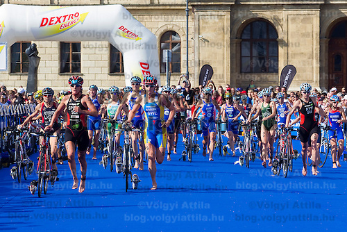Competitors arive to the depot with their bikes to change for runnging during the ITU women's elite triathlon world championships series final in Budapest, Hungary, Sunday, 12. September 2010. ATTILA VOLGYI
