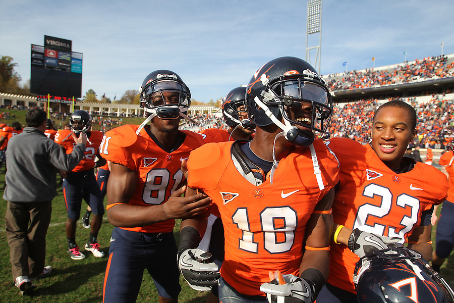 Oct. 30, 2010. Virginia Cavaliers wide receiver Dontrelle Inman (81), Virginia Cavaliers wide receiver Kris Burd (18) and Virginia Cavaliers safety Dom Joseph (23) celebrate the 24-19 upset win over the Miami Hurricanes at Scott Stadium. Photo/Andrew Shurtleff