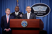 United States President Barack Obama delivers a statement on the counter-ISIL campaign in the Pentagon briefing room December 14, 2015 in Arlington, Virginia. President Obama met previously with a National Security Council on the counter-ISIL campaign. Pictured from left, US Secretary of Defense Ash Carter and Commander of US Central Command General Lloyd Austin.<br /> Credit: Olivier Douliery / Pool via CNP