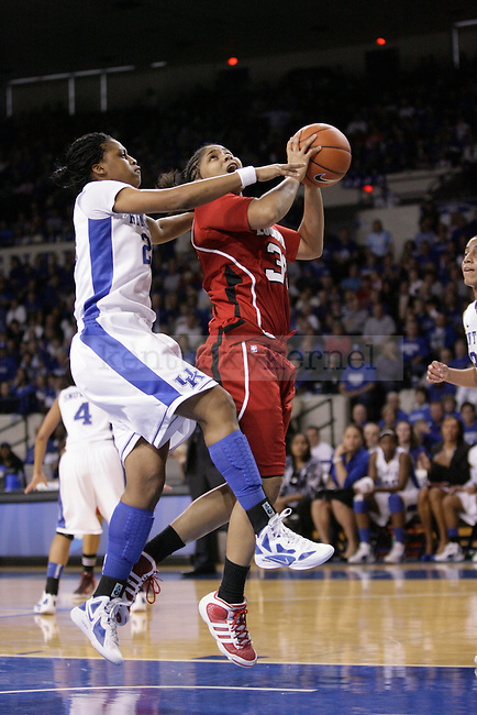 UK forward Bra' Shey Ali attempts to block a shot during the first half of the UK Women's basketball game against Louisville on 12/4/11 in Lexington, Ky. Photo by Quianna Lige | Staff