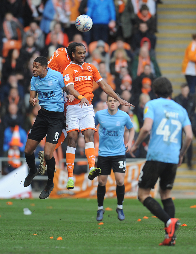 Blackpool's Donervon Daniels and Nathan Delfouneso vie for possession with Southend United's Timothee Dieng<br /> <br /> Photographer Kevin Barnes/CameraSport<br /> <br /> The EFL Sky Bet League One - Blackpool v Southend United - Saturday 9th March 2019 - Bloomfield Road - Blackpool<br /> <br /> World Copyright © 2019 CameraSport. All rights reserved. 43 Linden Ave. Countesthorpe. Leicester. England. LE8 5PG - Tel: +44 (0) 116 277 4147 - admin@camerasport.com - www.camerasport.com