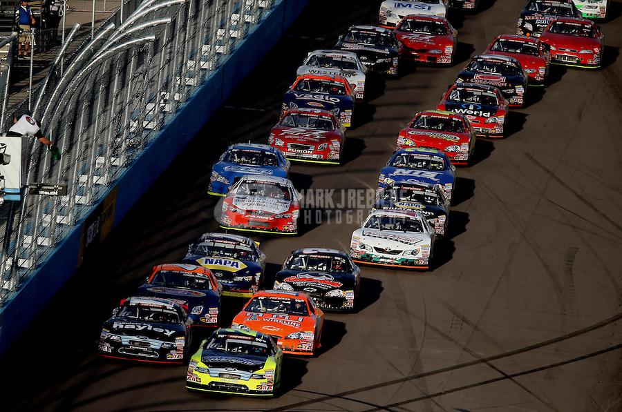 Mar. 2, 2013; Avondale, AZ, USA; NASCAR K&N Pro Series West driver Greg Pursley (front right) leads the field on a restart during the Talking Stick Resort 60 at Phoenix International Raceway. Mandatory Credit: Mark J. Rebilas-