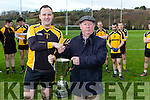 Peter Dennehy presents Liebherr captain Colin Myers the Inter Firm cup after defeating  Intel in the All Ireland Inter Firm final in Fossa on Saturday